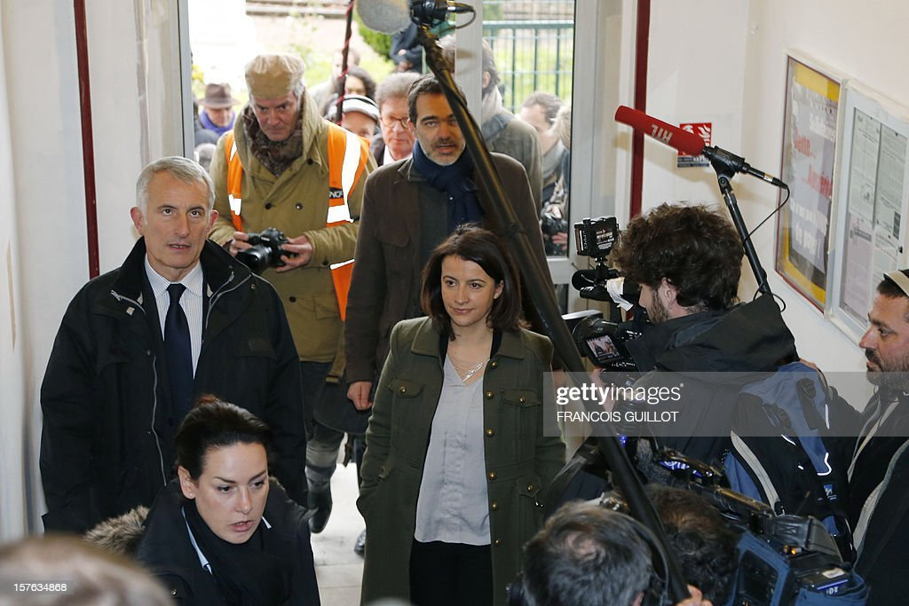 French Minister for Equality of Territories and Housing Cecile Duflot (C) and France national rail company SNCF head, Guillaume Pepy (L) visit a building belonging to French railway company SNCF and which will be used as temporary housing for homeless on December 5, 2012 in Ivry-sur-Seine. AFP PHOTO FRANCOIS GUILLOT