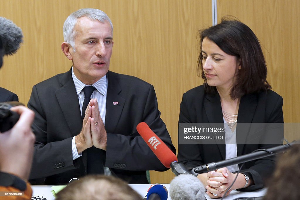 French Minister for Equality of Territories and Housing Cecile Duflot (R) and France national rail company SNCF head, Guillaume Pepy (L) give a press conference to present a building belonging to French railway company SNCF and which will be used as temporary housing for homeless on December 5, 2012 in Ivry-sur-Seine. AFP PHOTO FRANCOIS GUILLOT