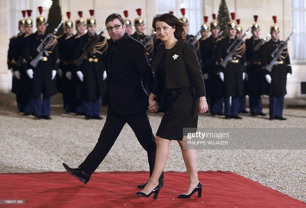 French Minister for Equality of Territories and Housing, Cecile Duflot (C) and her husband Xavier Cantat arrive at the Elysee Palace in Paris, on December 11, 2012, to attend a state dinner given in honour of Brazil's President. Brazilian President Dilma Roussef is on a two-day visit to France.