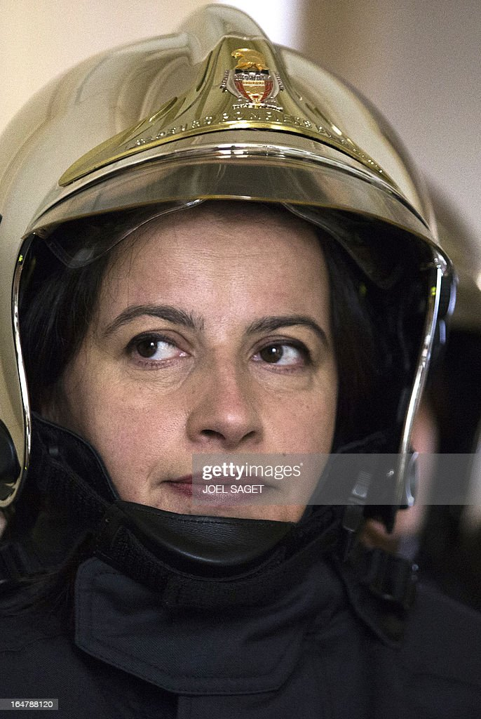 French Minister for Equality of Territories and Housing Cecile Duflot takes part in a firefighting exercise on March 28, 2013 in Paris, focused on benefits of smoke detectors.