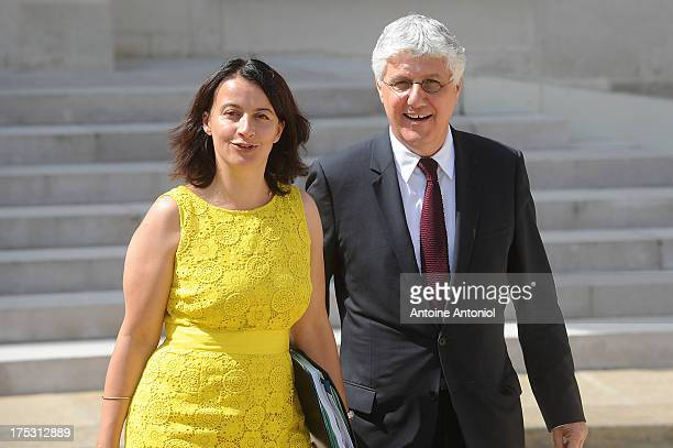 French Minister for Equality of Territories and Housing Cecile Duflot and French Ecology Minister Philippe Martin leave Elysee Palace after attending...