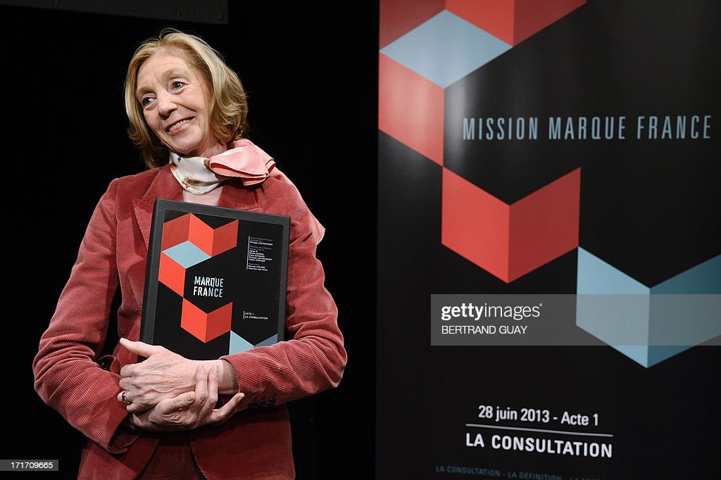 French minister for External Trade Nicole Bricq holds a report on the label Franceafter its official presentation on June 28, 2013 in Paris. The label France, aims at improving the reputation of French economy by promoting French products and services.