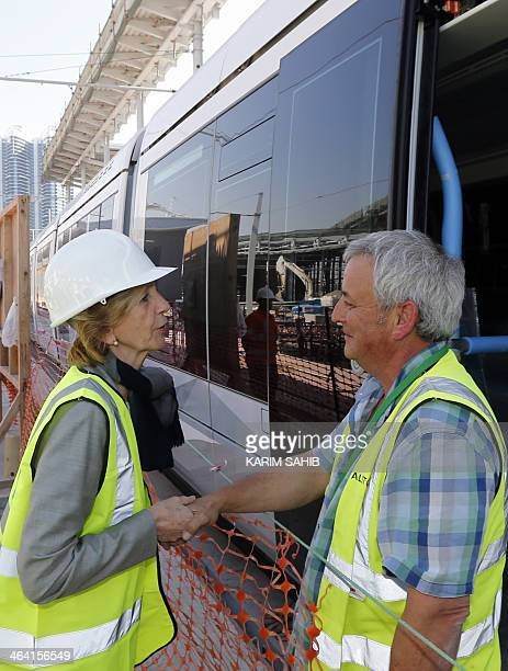 French Minister for Foreign Trade Nicole Bricq meets with a forgein worler as she visits the first tram delivered by the French company Alstom to the...