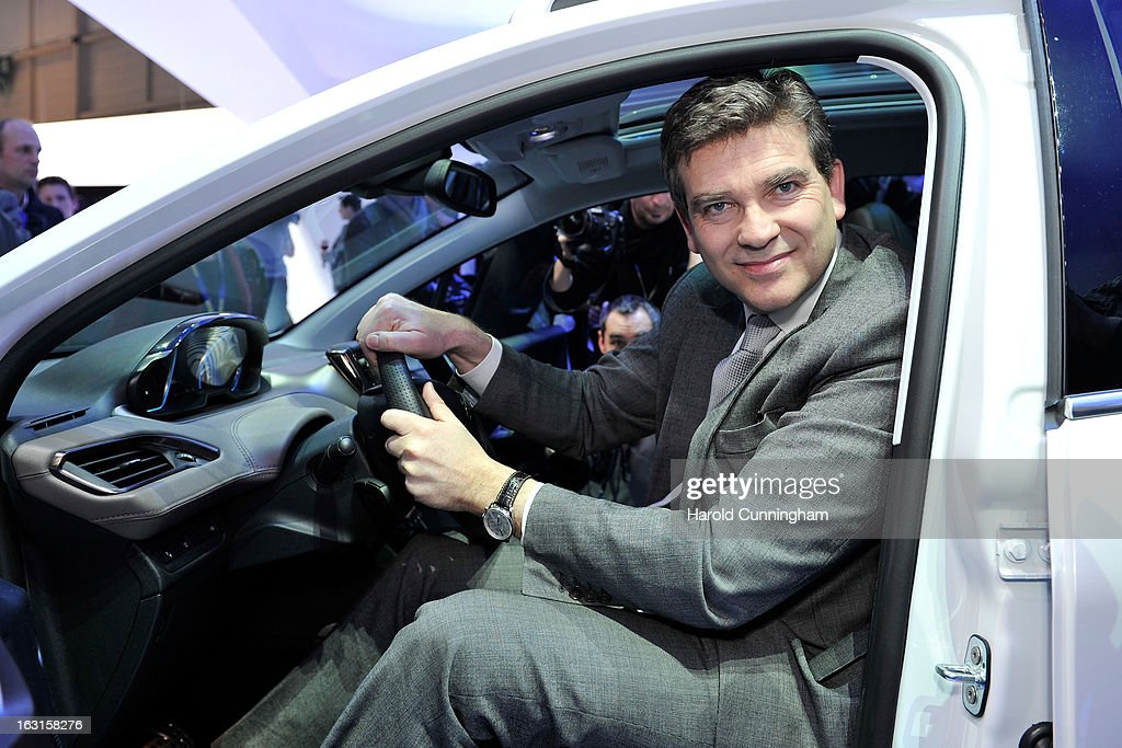 French Minister for Industrial Recovery <a gi-track='captionPersonalityLinkClicked' href=/galleries/search?phrase=Arnaud+Montebourg&family=editorial&specificpeople=588268 ng-click='$event.stopPropagation()'>Arnaud Montebourg</a> visits the Peugeot booth during the 83rd Geneva Motor Show on March 5, 2013 in Geneva, Switzerland. Held annually with more than 130 product premiers from the auto industry unveiled this year, the Geneva Motor Show is one of the world's five most important auto shows.