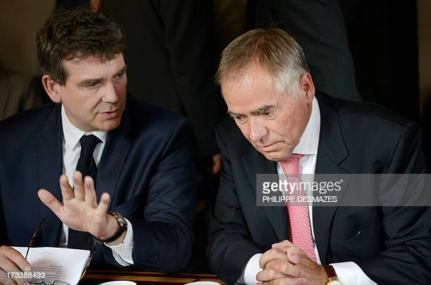 French Minister for Industrial Renewal and Food Industry Arnaud Montebourg gestures as he talks with president of TRIMET German HeinzPeter Schlüter...