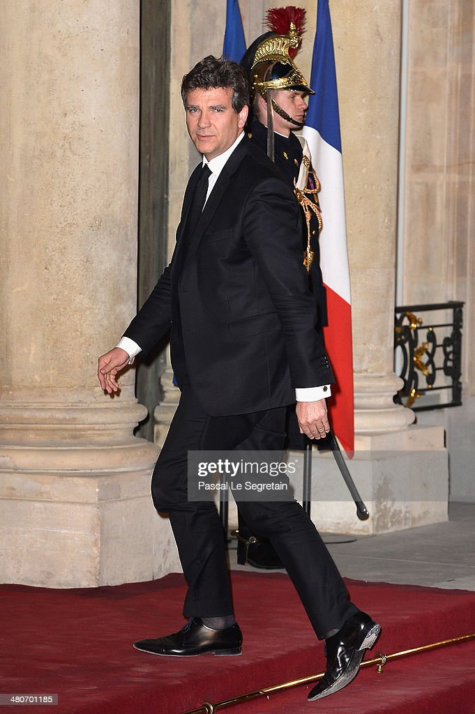 French Minister for Industrial Renewal and Food Industry <a gi-track='captionPersonalityLinkClicked' href=/galleries/search?phrase=Arnaud+Montebourg&family=editorial&specificpeople=588268 ng-click='$event.stopPropagation()'>Arnaud Montebourg</a> arrives at the Elysee Palace for an official dinner hosted by French President Francois Hollande as part of a two days State visit of the Chinese President Xi Jinping on March 26, 2014 in Paris, France.