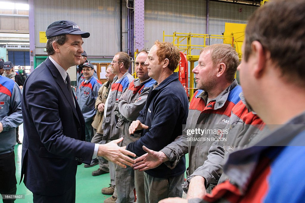 French Minister for Industrial Renewal and Food Industry Arnaud Montebourg (L) shakes hands with employees during a visit to a factory of French multinational engineering group Alstom in Belfort on March 22, 2013.