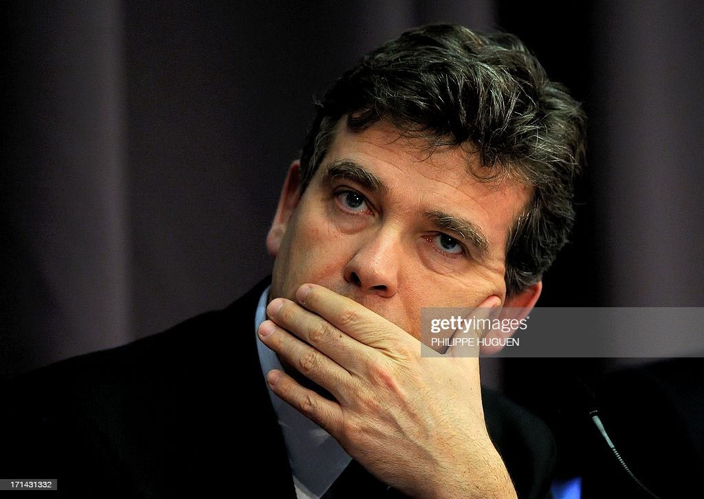 French minister for Industrial Renewal Arnaud Montebourg (C) attends a press conference at Lille's technology hub Euratechnologies, northern France, on June 24, 2013 to announce the opening of a new IBM service center in Lille.