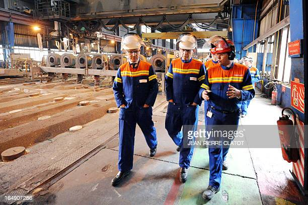 French Minister for Industrial Renewal Arnaud Montebourg flanked by French Junior Minister for European Affairs Thierry Repentin visits the Rio Tinto...