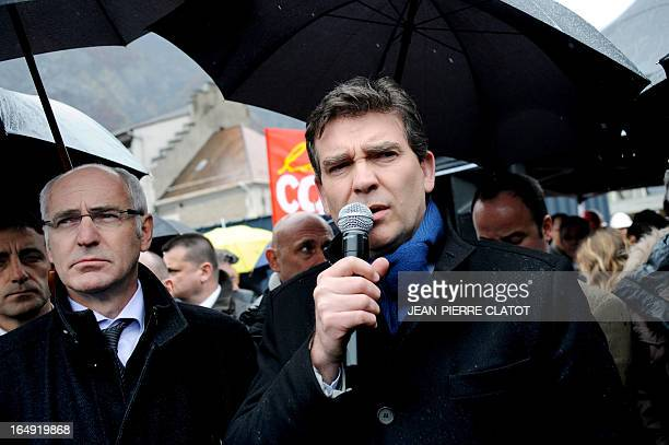 French Minister for Industrial Renewal Arnaud Montebourg flanked by French Junior Minister for European Affairs Thierry Repentin speaks to employees...