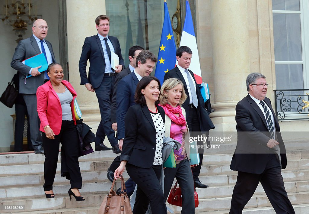 French Minister for Industrial Renewal Arnaud Montebourg (C), French Interior Minister Manuel Valls (2nd row-R), French Justice Minister Christiane Taubira (2L), French Minister for Equality of Territories and Housing Cecile Duflot (front-C), French Junior Minister in charge of French nationals abroad Helene Conway-Mouret (front-2R), French Junior Minister in Charge of Relations with the Parliament Alain Vidalies (R) leave along with other ministers the Elysee Presidential Palace after a special meeting, on May 6, 2013 in Paris. French President Francois Hollande, French Prime Minister Jean-Marc Ayrault and most of the embattled Socialist government's ministers held talks at the Elysee Palace to set the administration's reform agenda for the coming months. Hollande is marking the anniversary of his May 6 win last year over right-winger Nicolas Sarkozy as the most unpopular president in modern French history.