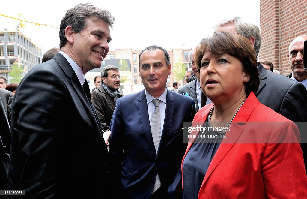 French minister for Industrial Renewal Arnaud Montebourg (L), IBM France's president Alain Benichou (C), and Lille's socialist mayor Martine Aubry (R) arrive at Lille's technology hub Euratechnologies, northern France, on June 24, 2013 to announce the opening of a new IBM center.