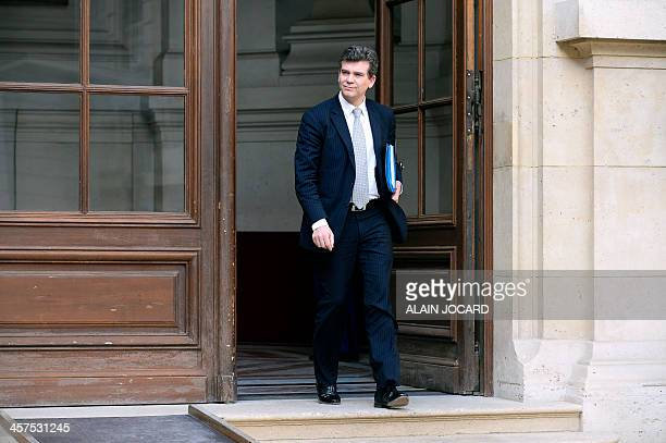 French Minister for Industrial Renewal Arnaud Montebourg leaves the Marigny hotel in Paris after the weekly cabinet meeting on December 18 2013 AFP...