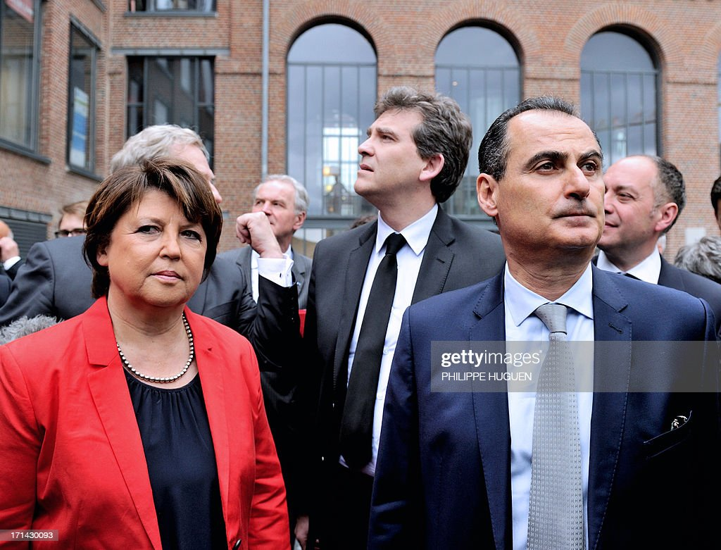French minister for Industrial Renewal Arnaud Montebourg (C), Lille's socialist mayor Martine Aubry (L) and IBM France's president Alain Benichou (R) arrive at Lille's technology hub Euratechnologies, northern France, on June 24, 2013 to announce the opening of a new IBM service center. AFP PHOTO / PHILIPPE HUGUEN
