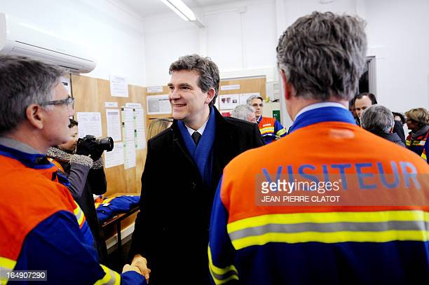 French Minister for Industrial Renewal Arnaud Montebourg meets employees during a visit at the Rio Tinto Alcan factory on March 29 2013 in...