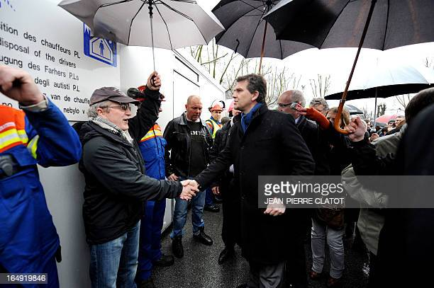 French Minister for Industrial Renewal Arnaud Montebourg meets employees after a visit at the Rio Tinto Alcan aluminium factory on March 29 2013 in...