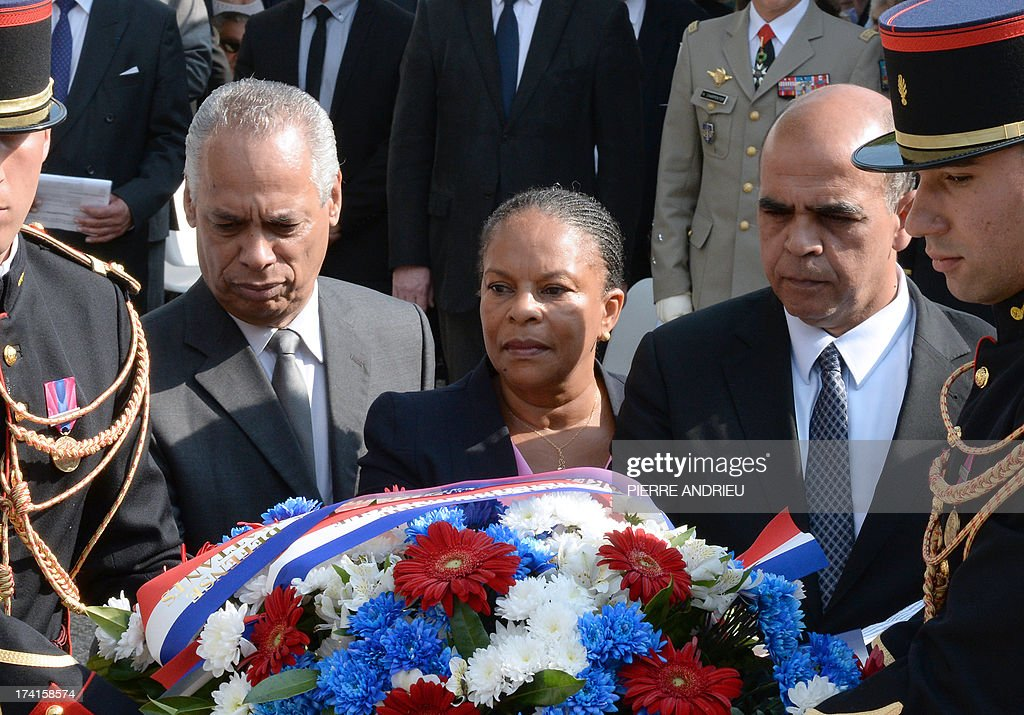 French Minister for Overseas Territories Victorin Lurel, Justice Minister Christiane Taubira and Junior Minister for Veterans Kader Ari prepare to lay a wreath during a ceremony commemorating the 71st anniversary of the roundup of the Vel d'hiv (Rafle du Velodrome d'Hiver) on July 21, 2013 in Paris. On July 16 and 17, 1942, some 13,000 Jews, mostly of non-French origin, were detained and taken to the Velodrome d'Hiver cycling stadium near the Eiffel Tower, where they spent a week in appalling conditions, before being deported to Nazi concentration camps. AFP PHOTO / PIERRE ANDRIEU
