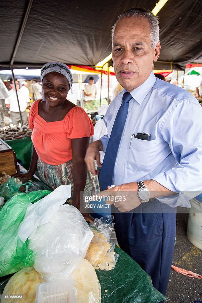 French Minister for Overseas Territories Victorin Lurel (R), visits a market on September 22, 2012 in Cayenne.