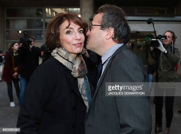 French Minister for Social Affairs and Health Marisol Touraine is greeted by director of Paris' public assistance hospitals APHP Martin Hirsch during...