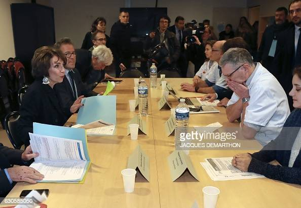 French Minister for Social Affairs and Health Marisol Touraine speaks with the head of the Emergency Department at the SaintAntoine hospital...