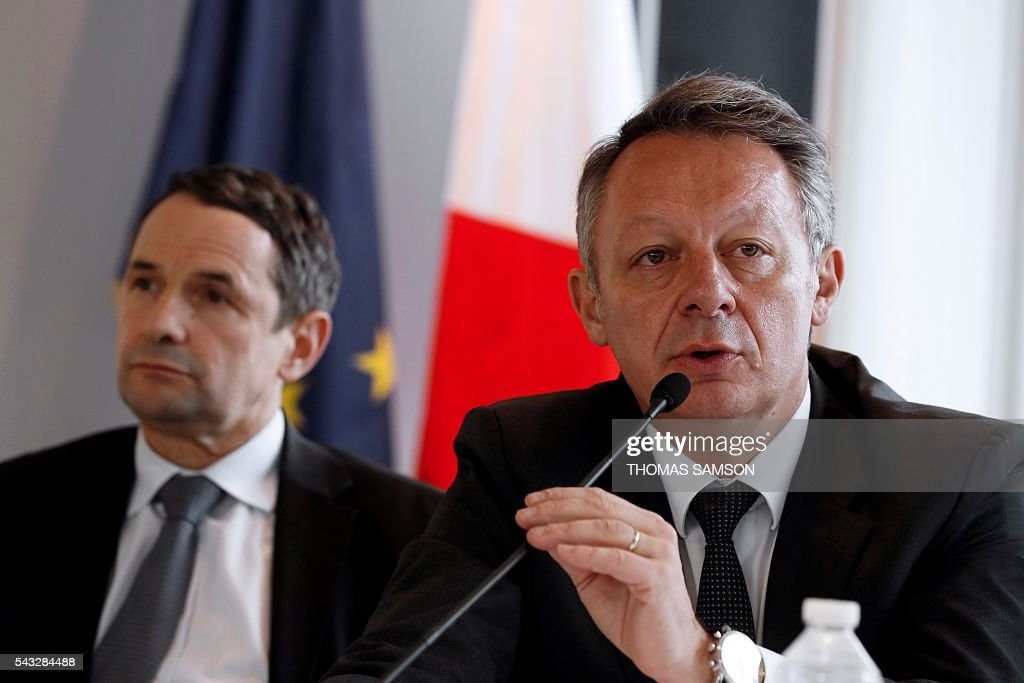 French Minister for Sports Thierry Braillard (R), flanked by French Minister for Higher Education and Research Thierry Mandon (L), speaks during a press conference on mechanical fraud, in Paris, on June 27, 2016. Thermal cameras will be used in this year's Tour de France to fight against motor cheats, French Minister of State for Sport Thierry Braillard announced on Monday. The cameras, which can detect a motor in a bicycle, have been developed by the Atomic Energy Commission (CEA) at the request of the French government. / AFP / Thomas SAMSON