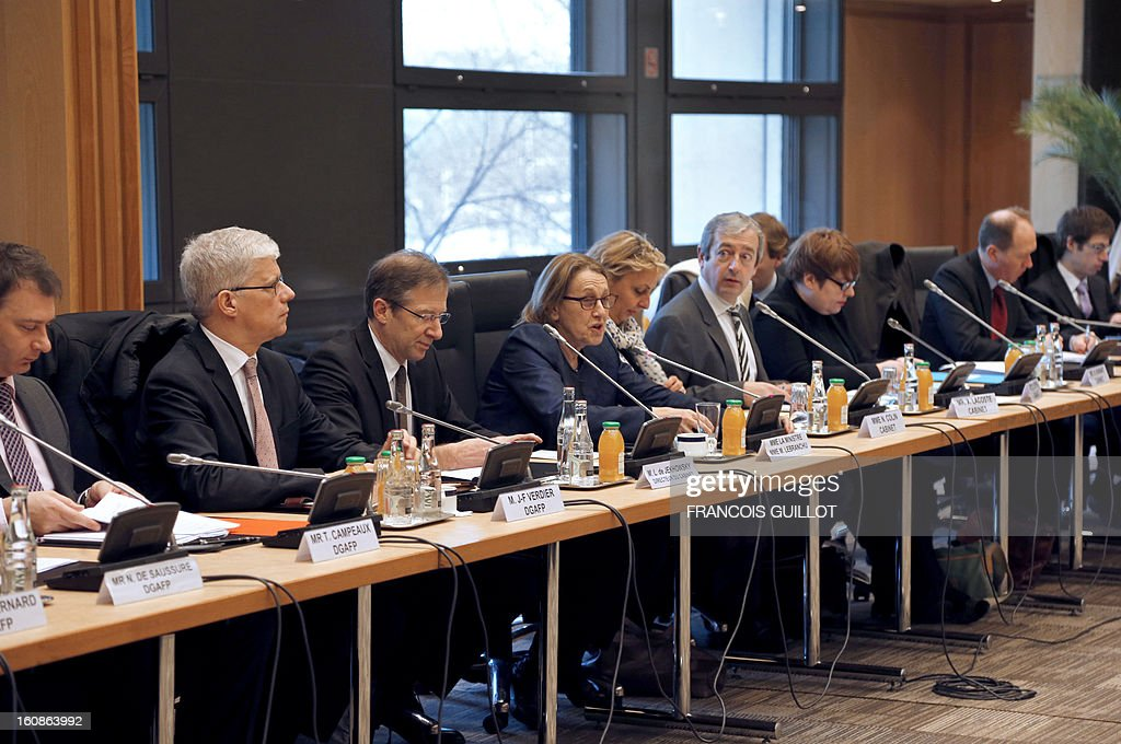 French Minister for State Reform, Decentralisation and Public Administration, Marylise Lebranchu (C) heads a roundtable meeting focused on wages with representatives of civil servants' unions, on February 7, 2013 in Paris.