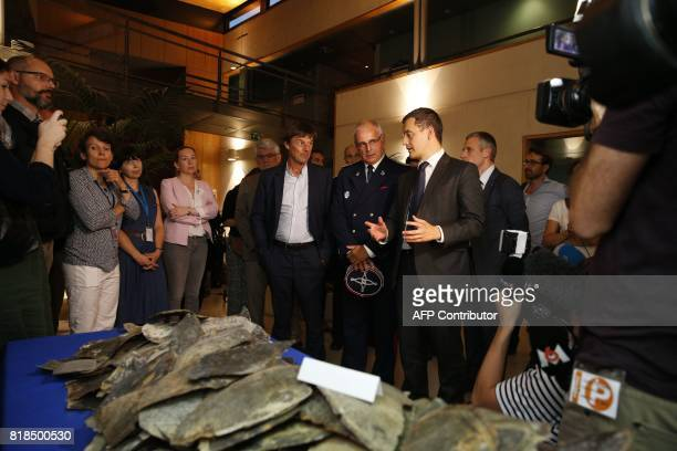 French Minister for the Ecological and Inclusive Transition Nicolas Hulot and French Minister of Public Action and Accounts Gerald Darmanin talk with...