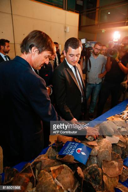 French Minister for the Ecological and Inclusive Transition Nicolas Hulot and French Minister of Public Action and Accounts Gerald Darmanin look at...