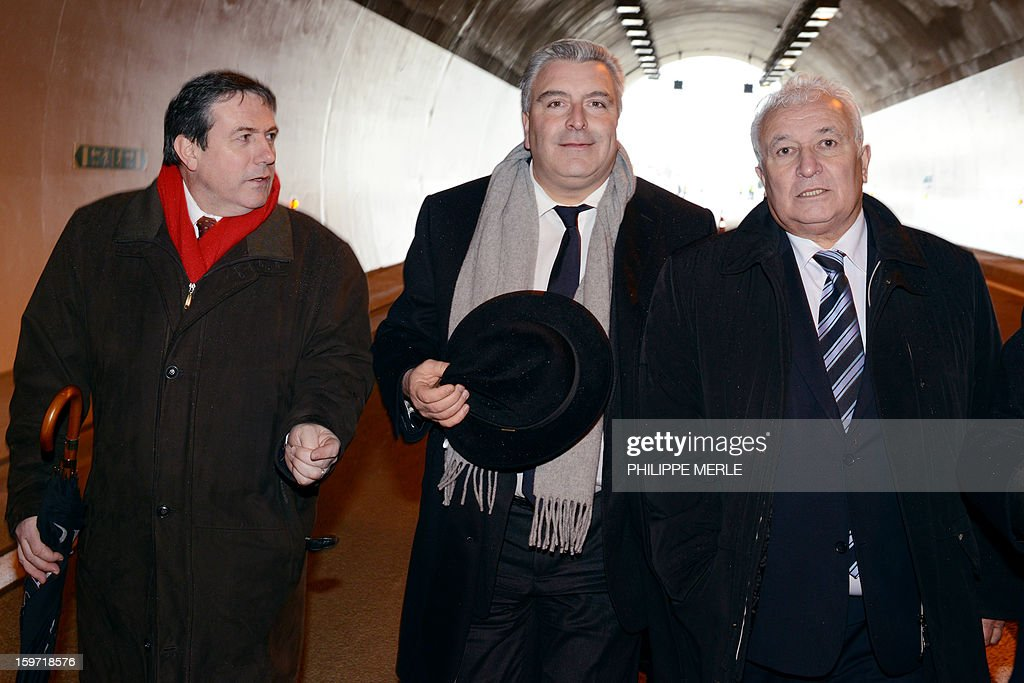 French minister for Transports and Maritime Economy Frederic Cuvillier (C) arrives on January 19, 2013 to the inauguration ceremony for the openning of the first section of the A89 tollway, in Balbigny, France's Loire valley. The new route is the first transversal highway across France and links Bordeaux to Lyon.