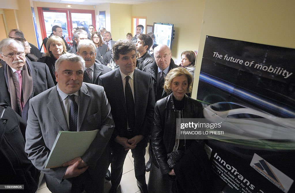 French minister for Transports and Maritime Economy Frederic Cuvillier (L), French Industrial Renewal Minister Arnaud Montebourg (C), and French Minister for Foreign Trade Nicole Bricq (R) arrive to visit a Deprecq rolling railway equipment factory on January 11, 2013 in Raismes.
