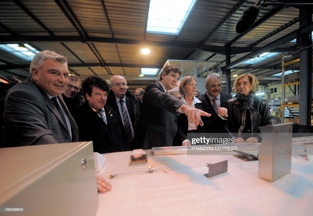 French minister for Transports and Maritime Economy Frederic Cuvillier (L), French Industrial Renewal Minister Arnaud Montebourg (C), French Minister for Foreign Trade Nicole Bricq (R) and Deprecq group CEO Antoinette Cousin (C) visit a Deprecq rolling railway equipment factory on January 11, 2013 in Raismes.