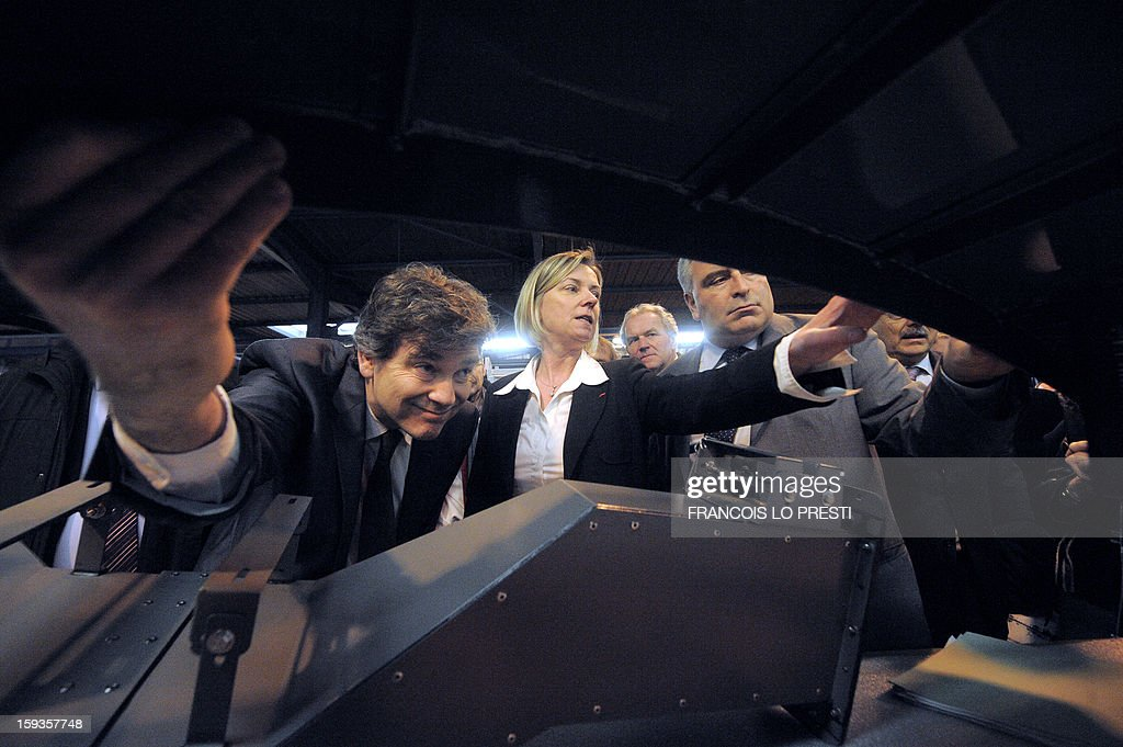 French minister for Transports and Maritime Economy Frederic Cuvillier (R), French Industrial Renewal Minister Arnaud Montebourg (L), and Deprecq group CEO Antoinette Cousin (C), visit a Deprecq rolling railway equipment factory on January 11, 2013 in Raismes.
