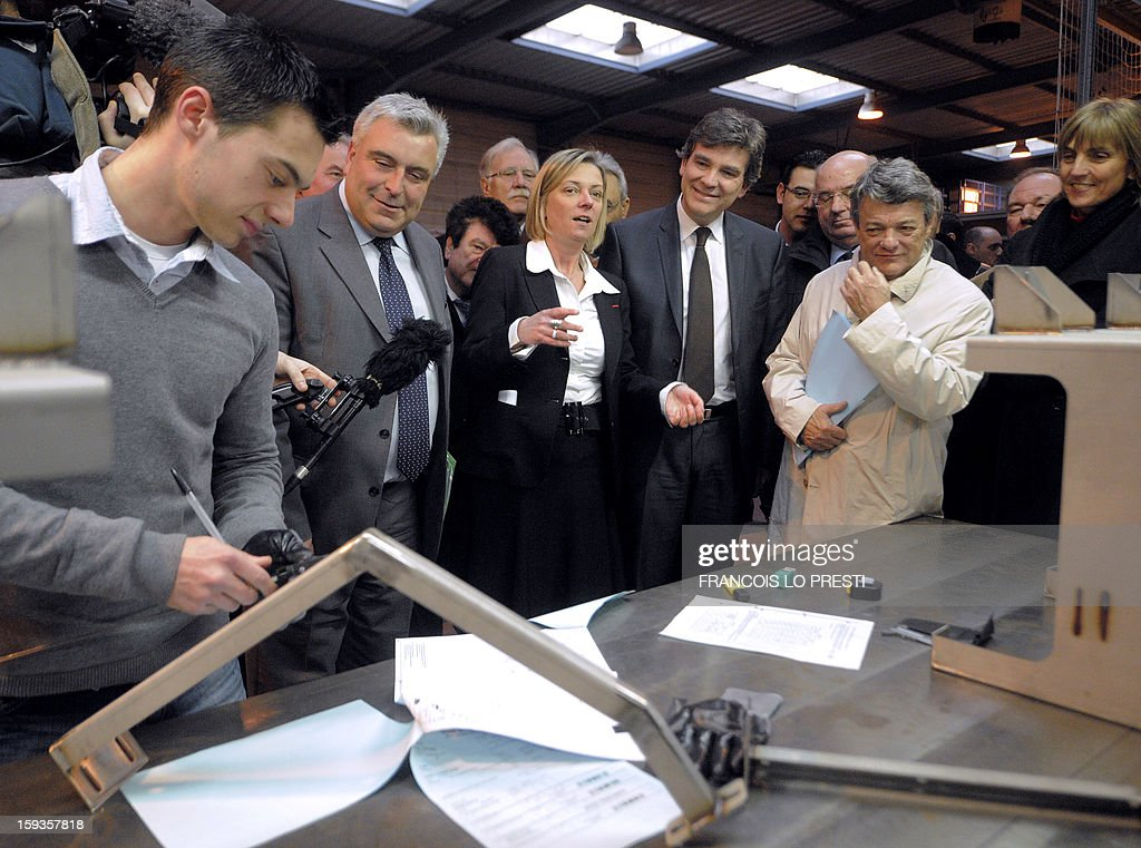 French minister for Transports and Maritime Economy Frederic Cuvillier (2ndL), French Industrial Renewal Minister Arnaud Montebourg (C), Deprecq group CEO Antoinette Cousin (C), UDI president Jean-Louis Borloo (R) visit a Deprecq rolling railway equipment factory on January 11, 2013 in Raismes.