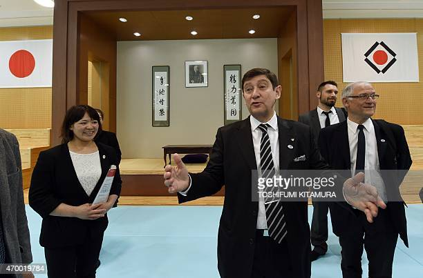 French Minister for Urban Youth and Sports Patrick Kanner inspects the Judo training room with Japan's twotime Olympic Judo gold medalist Ayumi...