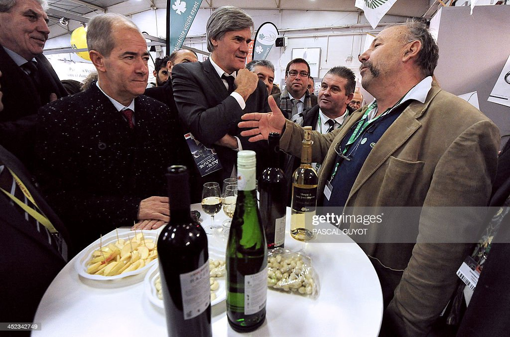 French Minister of Agriculture, Stéphane Le Foll (C) speaks with a farmer eyed by <a gi-track='captionPersonalityLinkClicked' href=/galleries/search?phrase=Christian+Bourquin&family=editorial&specificpeople=862462 ng-click='$event.stopPropagation()'>Christian Bourquin</a> (L), president of the Regional Council of Languedoc-Roussillon during his visit at the Sitevi international exhibition for the vine-wine, fruit-vegetable sectors, olive growing at the exibition hall in Montpellier, southern France, on November 28, 2013.