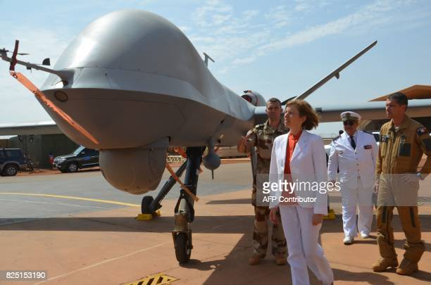 French Minister of Army Forces Florence Parly flanked by French officers of the Barkhane counterterrorism operation in Africa's Sahel region looks at...