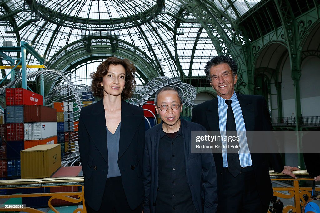 French Minister of Culture and Communication, Audrey Azoulay, Artist Huang Yong Ping and President of the 'Institut du Monde Arabe' Jack Lang attend the Huang Yong Ping Monumenta 2016 Exhibition opening at Le Grand Palais on May 9, 2016 in Paris, France.
