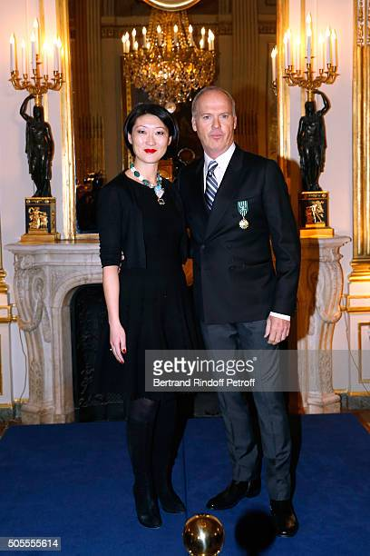 French minister of Culture and Communication Fleur Pellerin ad Michael Keaton attend Actor Michael Keaton received the medal of Officer of the Order...