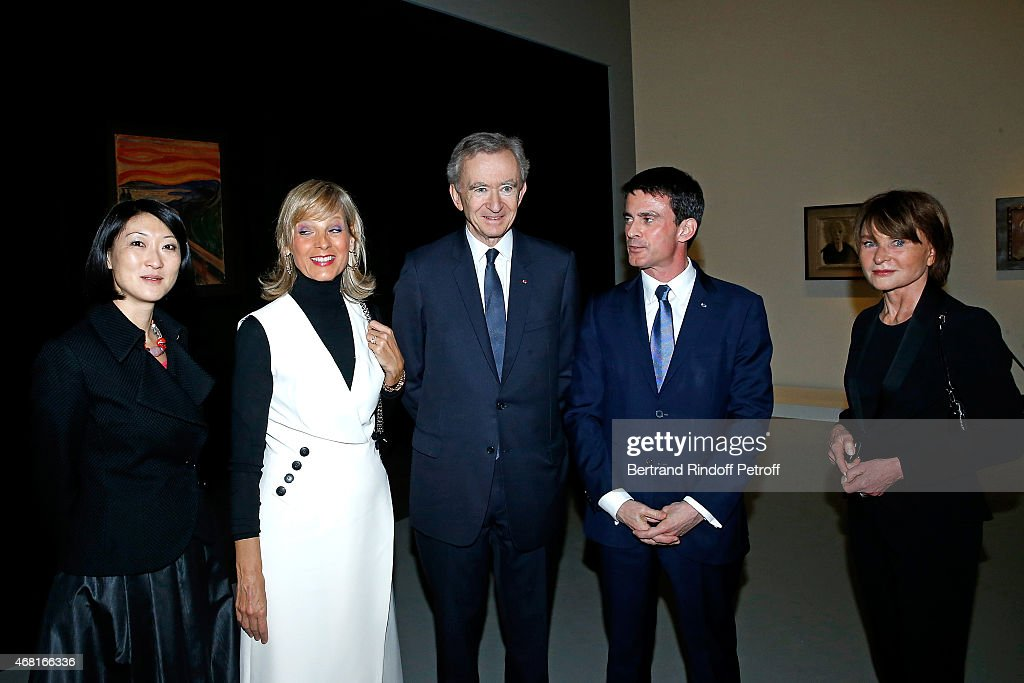 French minister of Culture and Communication <a gi-track='captionPersonalityLinkClicked' href=/galleries/search?phrase=Fleur+Pellerin&family=editorial&specificpeople=8784076 ng-click='$event.stopPropagation()'>Fleur Pellerin</a>, Helene Arnault, her husband Owner of LVMH Luxury Group <a gi-track='captionPersonalityLinkClicked' href=/galleries/search?phrase=Bernard+Arnault&family=editorial&specificpeople=214118 ng-click='$event.stopPropagation()'>Bernard Arnault</a>, French Prime Minister <a gi-track='captionPersonalityLinkClicked' href=/galleries/search?phrase=Manuel+Valls&family=editorial&specificpeople=2178864 ng-click='$event.stopPropagation()'>Manuel Valls</a> and Director of Louis Vuitton Fundation Suzanne Page attend the 'Les Clefs d'une Passion' Exhibition Preview. Held at Fondation Louis Vuitton on March 30, 2015 in Paris, France.