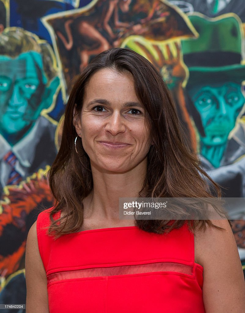 French Minister Of Culture <a gi-track='captionPersonalityLinkClicked' href=/galleries/search?phrase=Aurelie+Filippetti&family=editorial&specificpeople=4273748 ng-click='$event.stopPropagation()'>Aurelie Filippetti</a> poses in front of a painting of Jorg Immendorff ' Cafe de Flore' at Fondation Maeght exhibition as part of Festival Des Nuits du Sud at Fondation Maeght on July 27, 2013 in Saint-Paul-De-Vence, France.