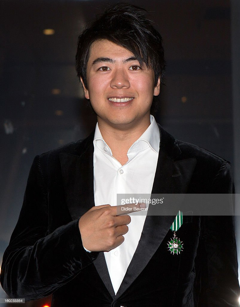 French minister of Culture Aurelie Filippetti rewards Chinese pianist Lang Lang withe the Insignes de Chevalier des Arts et Lettres medal at Palais des Festivals on January 27, 2013 in Cannes, France.
