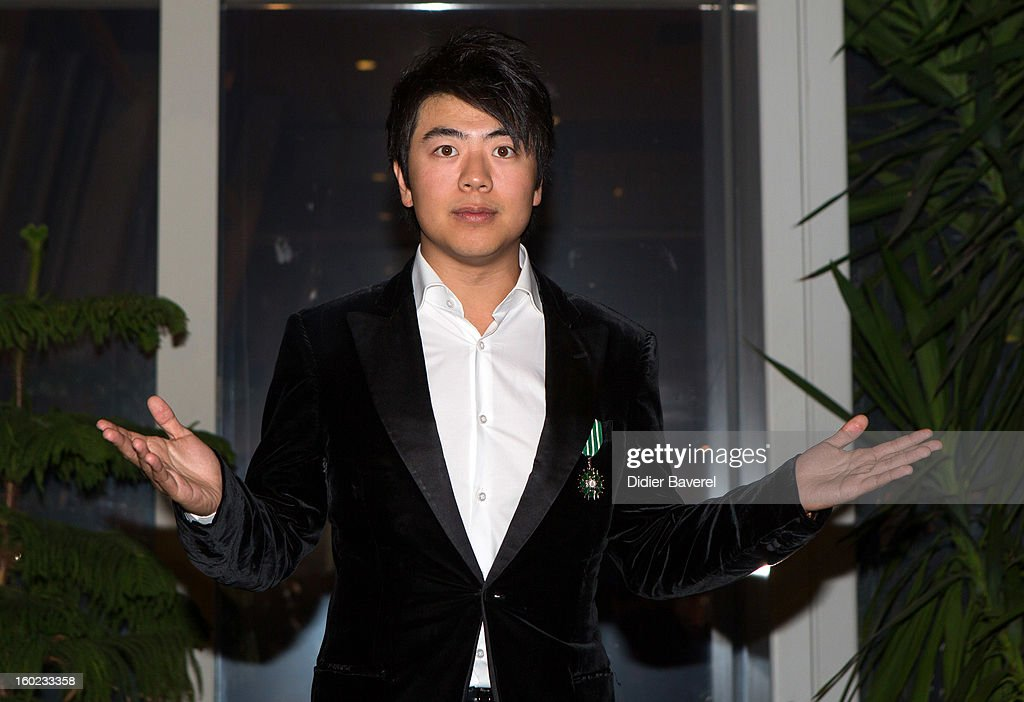 French minister of Culture Aurelie Filippetti rewards Chinese pianist <a gi-track='captionPersonalityLinkClicked' href=/galleries/search?phrase=Lang+Lang&family=editorial&specificpeople=589153 ng-click='$event.stopPropagation()'>Lang Lang</a> withe the Insignes de Chevalier des Arts et Lettres medal at Palais des Festivals on January 27, 2013 in Cannes, France.