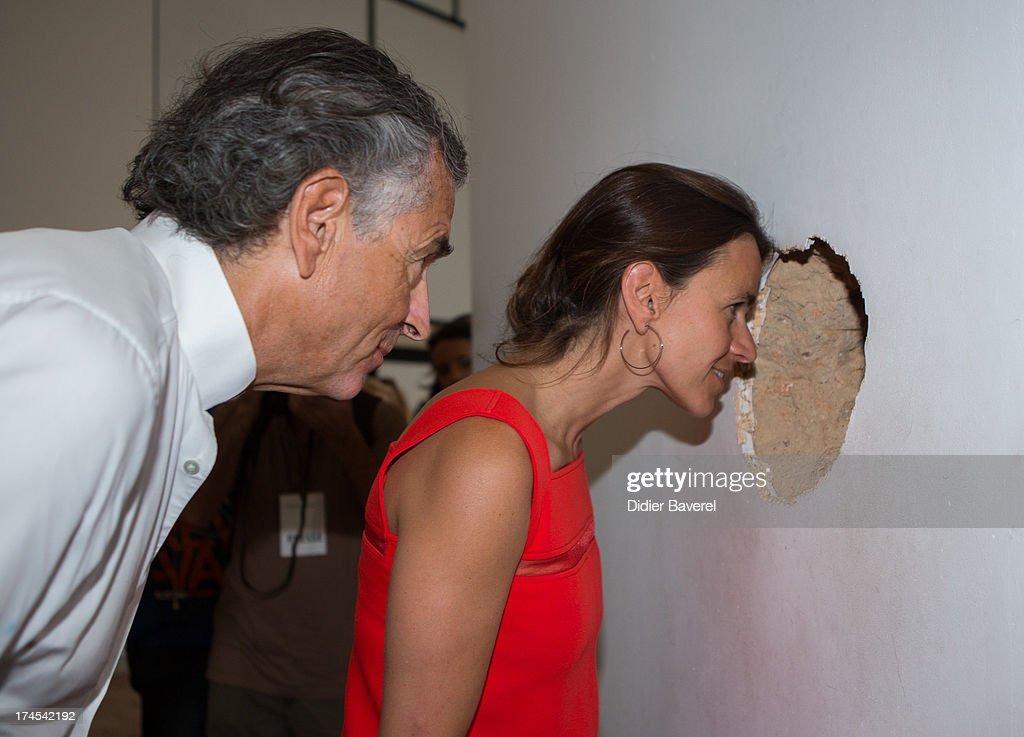 French Minister Of Culture <a gi-track='captionPersonalityLinkClicked' href=/galleries/search?phrase=Aurelie+Filippetti&family=editorial&specificpeople=4273748 ng-click='$event.stopPropagation()'>Aurelie Filippetti</a> visits Fondation Maeght exhibition with the curator, writer <a gi-track='captionPersonalityLinkClicked' href=/galleries/search?phrase=Bernard-Henri+Levy&family=editorial&specificpeople=793270 ng-click='$event.stopPropagation()'>Bernard-Henri Levy</a> as part of Festival Des Nuits du Sud at Fondation Maeght on July 27, 2013 in Saint-Paul-De-Vence, France.