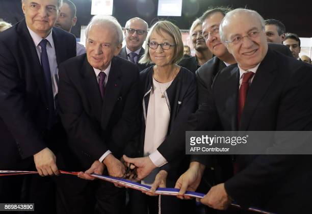 French Minister of Culture de Françoise Nyssen cuts the ribbon along with Lebanese Minister of Education Marwan Hamade and Minister of Culture...