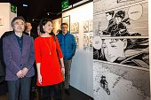 French Minister of Culture Fleur Pellerin poses next to Japanese cartoonist Jiro Taniguchi visit an exposition during the 42nd Angouleme...