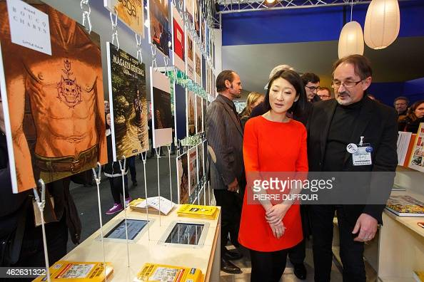French Minister of Culture Fleur Pellerin visits the 42nd Angouleme International Comics Festival on February 1 2015 AFP PHOTO / PIERRE DUFFOUR