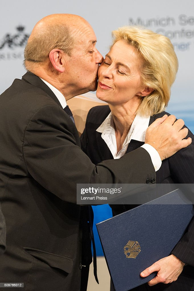 French Minister of Defense, Jean-Yves Le Drian, embraces german Defense Minister Ursula von der Leyen at the 2016 Munich Security Conference at the Bayerischer Hof hotel on February 12, 2016 in Munich, Germany. The annual event brings together government representatives and security experts from across the globe and this year the conflict in Syria will be the main issue under discussion.