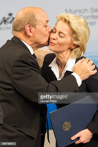French Minister of Defense JeanYves Le Drian embraces german Defense Minister Ursula von der Leyen at the 2016 Munich Security Conference at the...