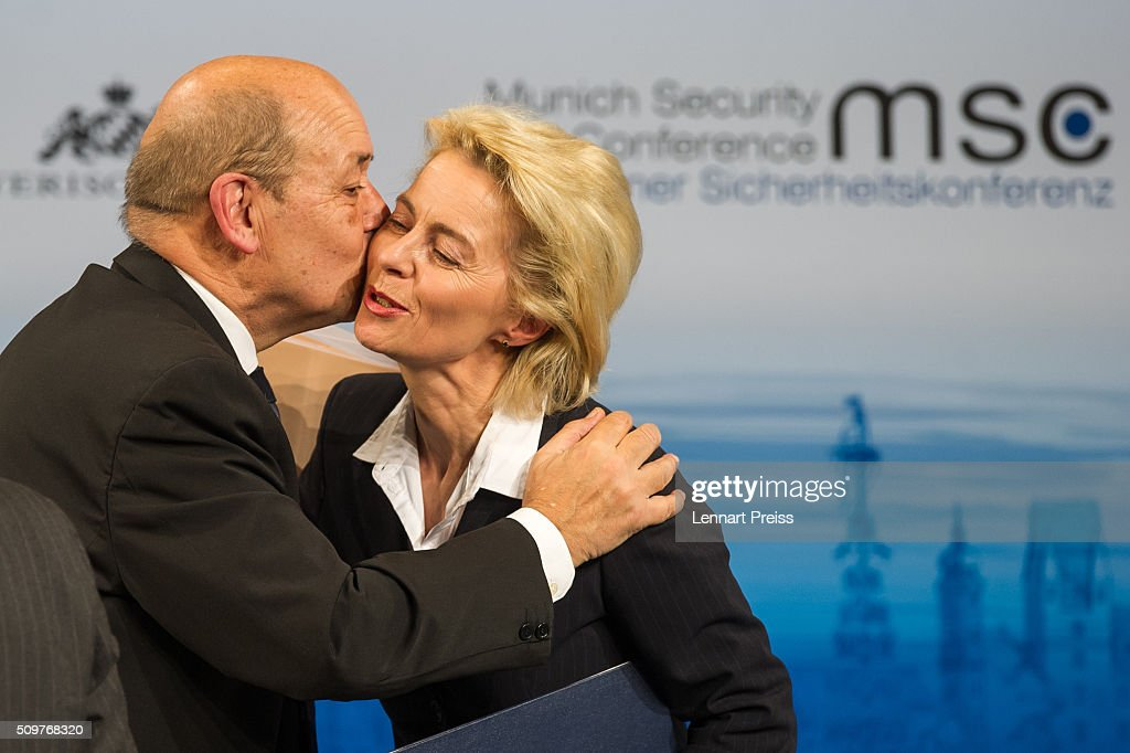 French Minister of Defense, <a gi-track='captionPersonalityLinkClicked' href=/galleries/search?phrase=Jean-Yves+Le+Drian&family=editorial&specificpeople=2122785 ng-click='$event.stopPropagation()'>Jean-Yves Le Drian</a>, embraces german Defense Minister <a gi-track='captionPersonalityLinkClicked' href=/galleries/search?phrase=Ursula+von+der+Leyen&family=editorial&specificpeople=4249207 ng-click='$event.stopPropagation()'>Ursula von der Leyen</a> at the 2016 Munich Security Conference at the Bayerischer Hof hotel on February 12, 2016 in Munich, Germany. The annual event brings together government representatives and security experts from across the globe and this year the conflict in Syria will be the main issue under discussion.
