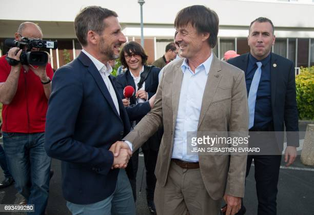 French Minister of Ecological and Inclusive Transition Nicolas Hulot shakes hands with Matthieu Orphelin candidate of 'La Republique En Marche' party...